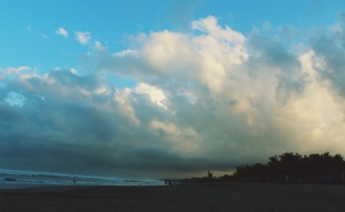 Clouds billowing off the mainland