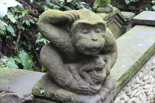 Stone statue scratching it's head